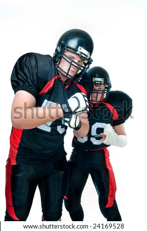 Two American football players in uniform over white background - stock photo