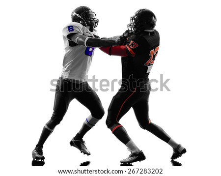 two american football players on scrimmage holding in silhouette shadow white background - stock photo