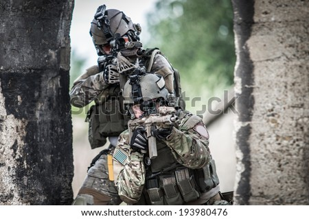 two american soldiers shooting through door  - stock photo