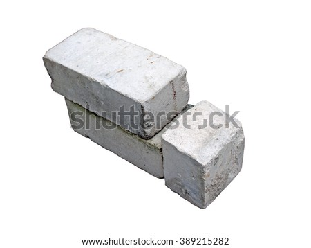 Two and half silicate bricks isolated on white background close up. - stock photo