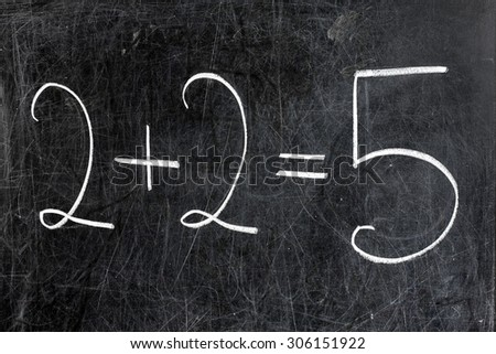 Two and two make five incorrect equation handwritten on blackboard - stock photo