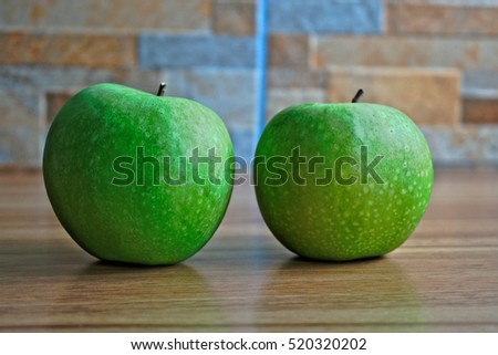 Two apples on a wooden table