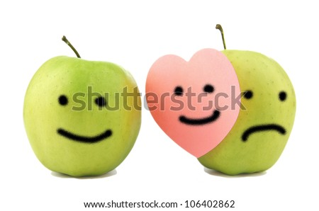 Two apples, smiling and crying on white. Concept of hypocrisy to hide feelings of emotion hold your sadness joy couples in romantic relationships and family - stock photo