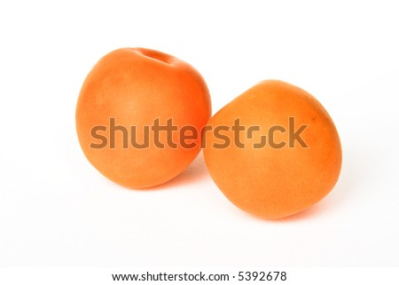 Two apricots isolated on white background - stock photo