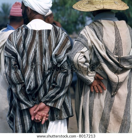 Two Arab man at a market in Morocco; seen from behind