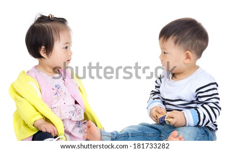 Two asia baby looking each other - stock photo