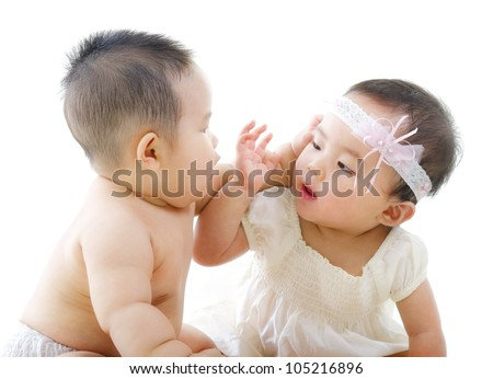 Two Asian babies having baby talk - stock photo