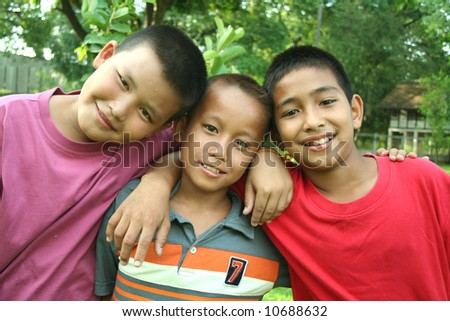 Two asian boys hanging in the park. - stock photo