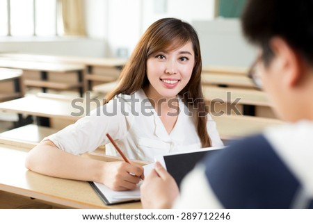 Two asian student discuss content on tablet when study in classroom
