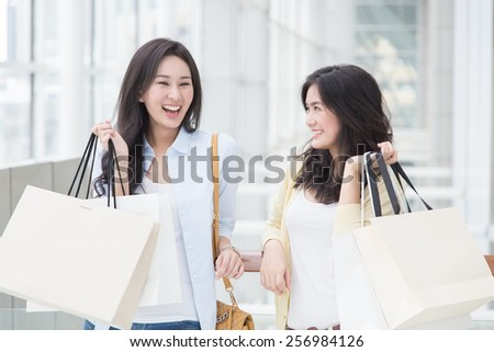 Two asian women enjoy shopping - stock photo