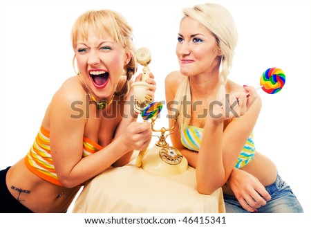 Two attractive blondes hanging out - stock photo
