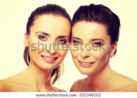 Two attractive sisters with make up.