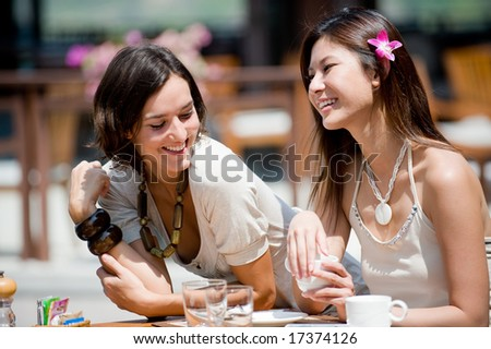 Two attractive women at breakfast on vacation