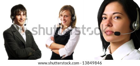 Two attractive young customer service representative ladies and a young call center operator guy are smiling and they are talking to their clients using headphones. They are wearing elegant shirts. - stock photo