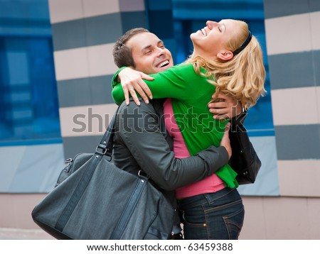 Two attractive young people met in the street and they are happy - stock photo