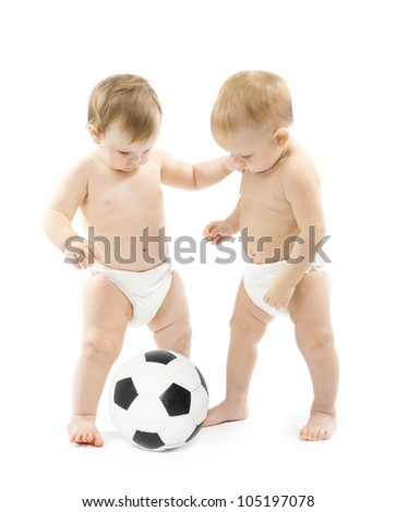 Two babies playing soccer ball over white background. Kids physical development