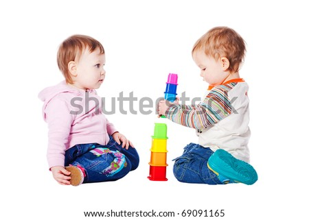 two babies playing with toy isolated - stock photo