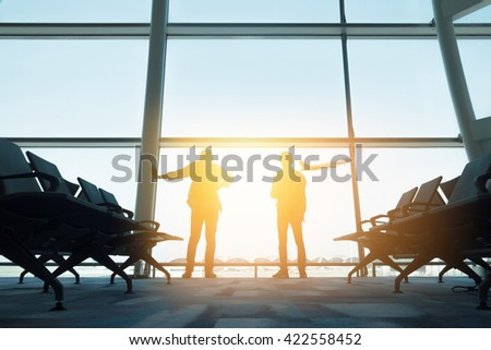 Two backpackers in hong kong airport - stock photo