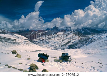 Two backpacks in high altitude south american Andes in Peru, Ausangate