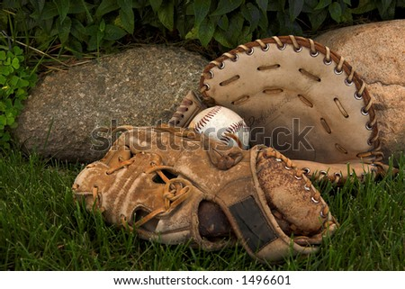 two ball gloves and a baseball - stock photo