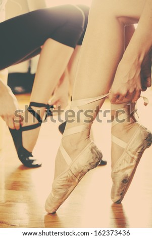 two ballerinas  in ballet shoes  put trough arty retro filter  - stock photo