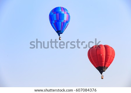 Two balloons in the sky.