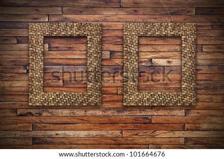 two bamboo frames on wood wall - stock photo