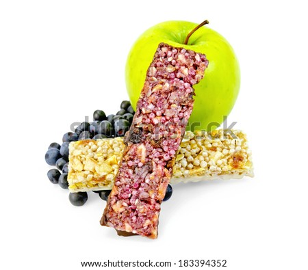 Two bar of muesli, green apple, blueberries isolated on white background - stock photo