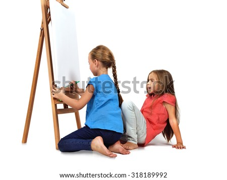 two barefoot girl is painting on blank easel - stock photo