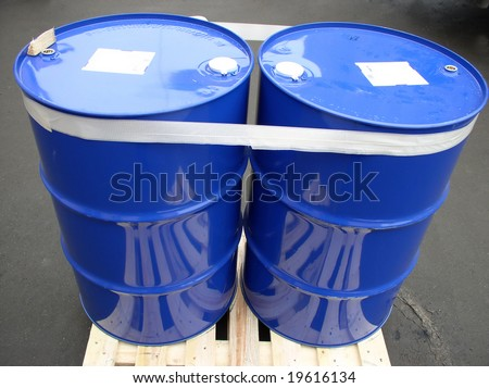two barrels bounded by adhesive tape - stock photo