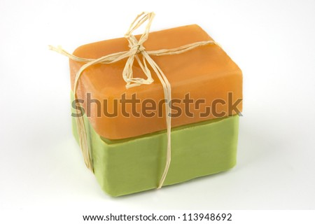 Two bars of natural soap with sandal and olive oil on white - stock photo