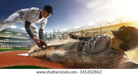 two baseball player the in action on grand arena - stock photo