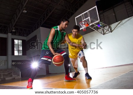 Two Basketball players competition game sport in stadium.