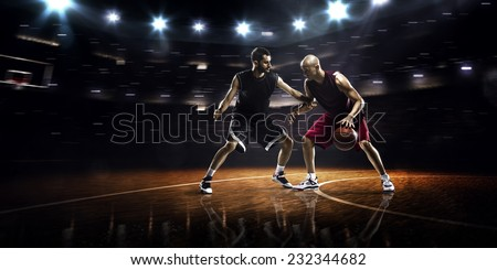 Two basketball players in action in gym  panorama view - stock photo