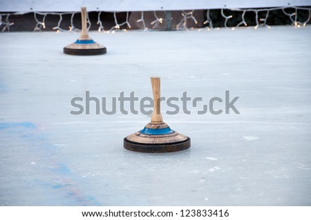 Two bavarian curling stones on an ice rink - stock photo