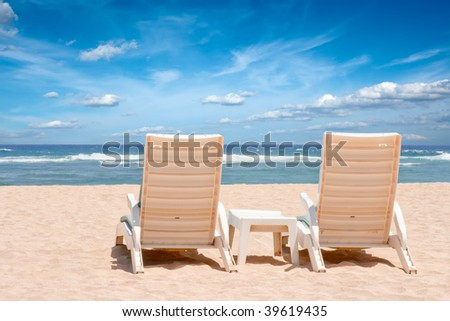 Two Beach Chairs For Sunbathing On Beach Near Ocean On Beach Resort Ready  For Honeymoon Couple