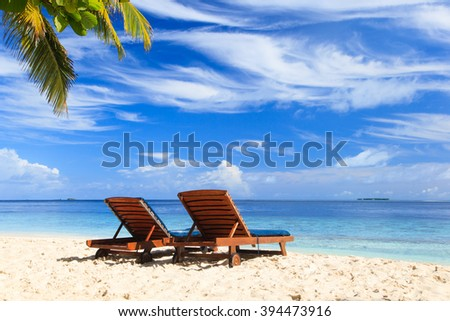 Two beach chairs on the tropical vacation