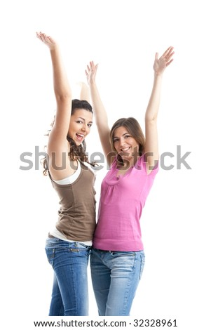 Two beautiful and happy young women isolated over white background