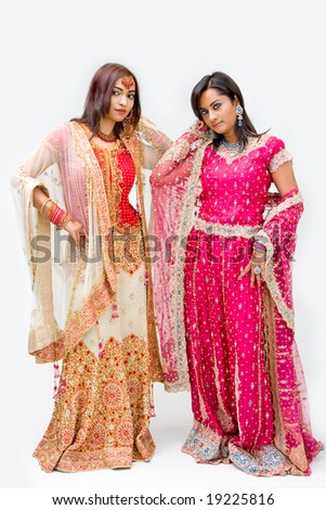 Two beautiful Bangali brides in colorful dresses, isolated - stock photo