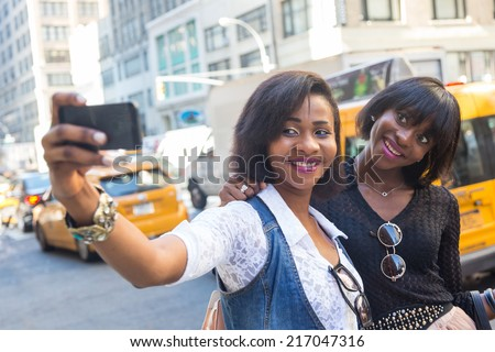 Two Beautiful Black Woman taking Selfie in New York - stock photo