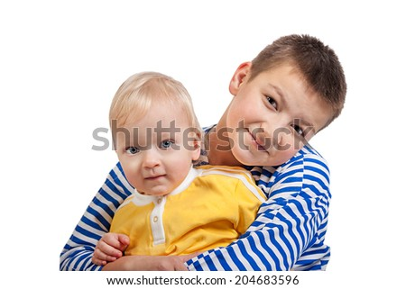 two beautiful boys  isolated on a white background - stock photo