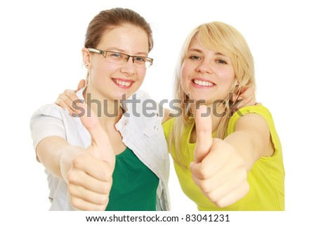 Two beautiful business woman giving thumbs up. Concept of successful partnership,isolated on white background