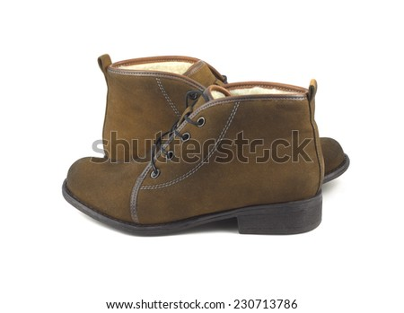 Two beautiful female brown suede boots isolated on white side view closeup - stock photo