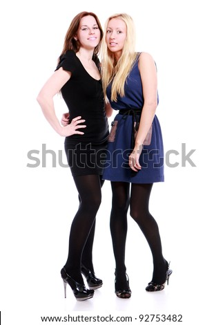 Two beautiful girlfriends on white background - stock photo