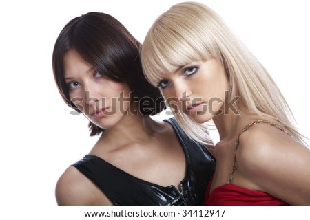 Two beautiful girls on a white background - stock photo