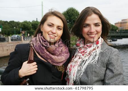 Two beautiful girls posing in City. - stock photo