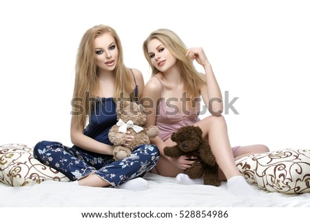 Two beautiful girls sitting in pajamas