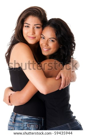 Two beautiful happy smiling young adult women hugging as best friends, isolated.
