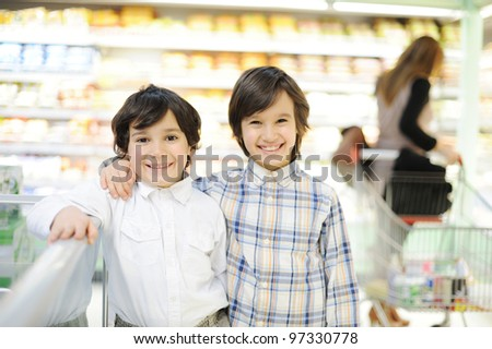 Two beautiful kids in shopping mall