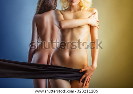 Two beautiful naked women on a blue and yellow background - stock photo